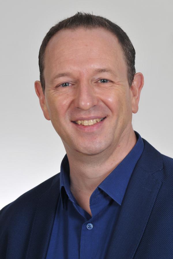 Dr. Michael Tunç